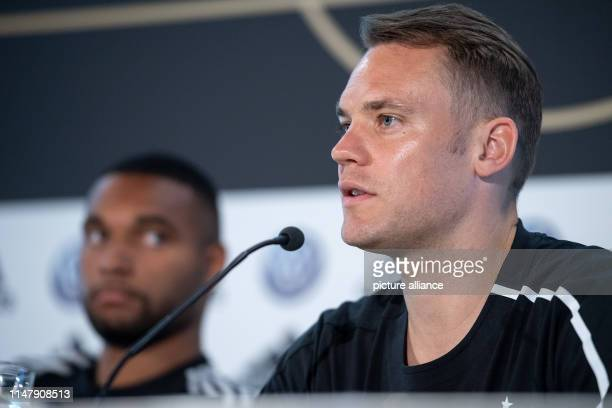 Goalkeeper Manuel Neuer speaks during a press conference Jonathan Tah sits on the left The national football team plays against Belarus and Estonia...