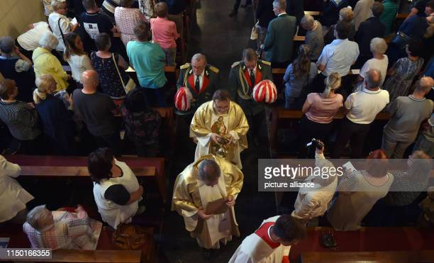 15 June 2019 North RhineWestphalia MerzenichMorschenich Pastor Andreas Galbierz carries the monstrance from the church during the divine service for...