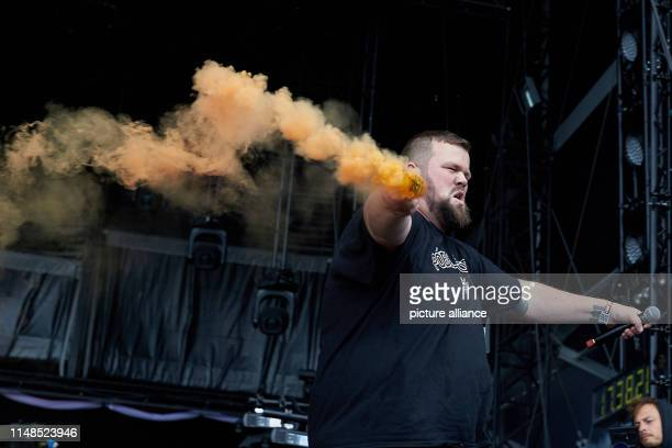 08 June 2019 RhinelandPalatinate Nürburg Frontman Jan Monchi Gorkow ignites pyrotechnics with his band Feine Sahne Fischfilet on the main stage of...