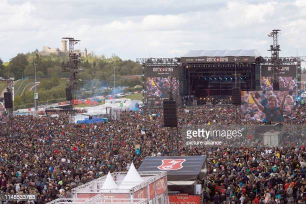 08 June 2019 RhinelandPalatinate Nürburg Rock fans crowd during the performance of the band Feine Sahne Fischfilet in front of the main stage of the...