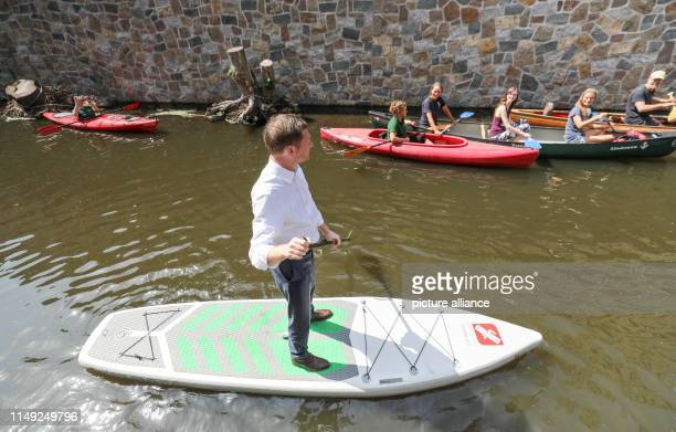 Michael Kretschmer Prime Minister of Saxony travels on a SUP board on the part of the Elstermühlgraben exposed after two and a half years of...