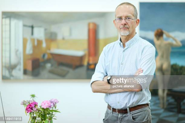 The painter Axel Krause stands in his studio After heated debates about the participation of the controversial artist the Leipzig annual exhibition...