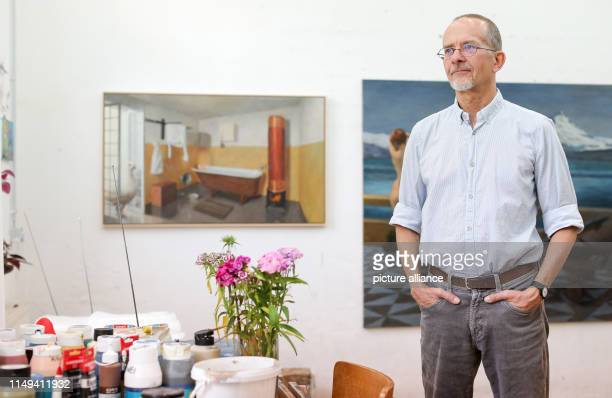 The painter Axel Krause stands in his studio in front of the pictures The dove from the roof and The dream of a butcher After heated debates about...