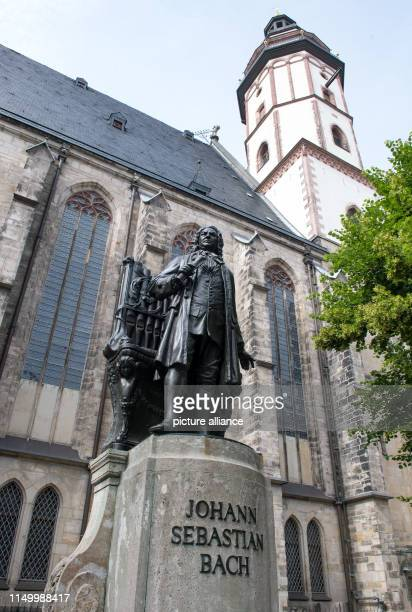 View of the monument for composer Johann Sebastian Bach in front of the Thomaskirche in Leipzig In the evening the Bach Festival 2019 will open here...