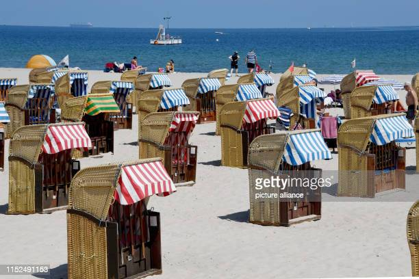 28 June 2019 SchleswigHolstein Travemünde Empty beach chairs stand at the Baltic Sea beach The Baltic Sea coast in SchleswigHolstein experiences a...