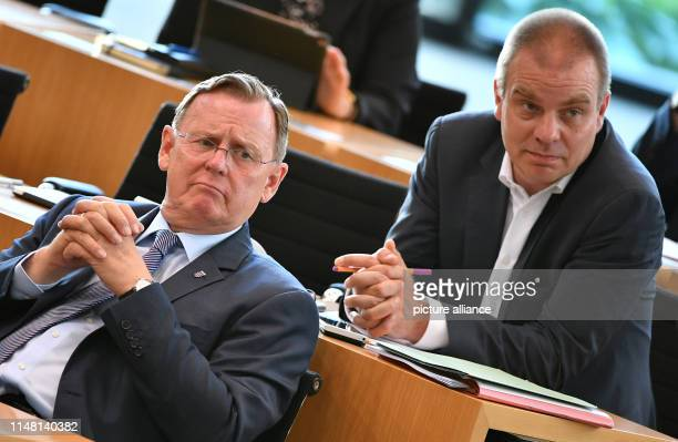 Bodo Ramelow Prime Minister of Thuringia and Malte Krückels Secretary of State for Culture of Thuringia are following a speech in the plenary hall at...