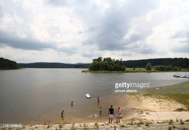 Visitors bathe at the dam The Heyda dam dam dams the Wipfra near Ilmenau in southern Thuringia The dam was built between 1980 and 1988 and was put...