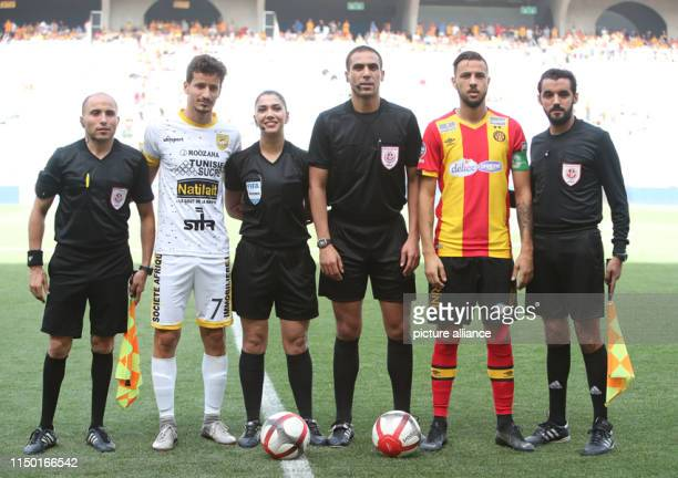 Dorsaf Ganoiati stand for a group picture with assistant referees and players ahead of the Tunisian Ligue Professionnelle 1 soccer match between...