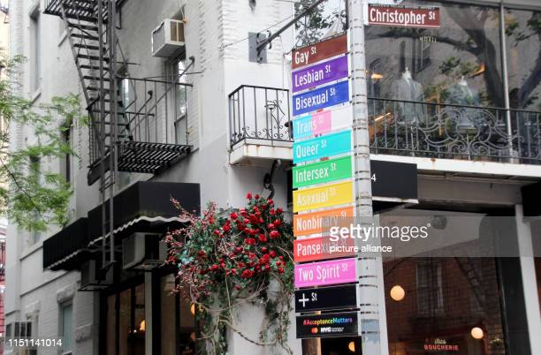 Colourful signs in rainbow colours including the inscription Intersex or Pansexual taken on Gay Street in the scene district of Greenwich Village...