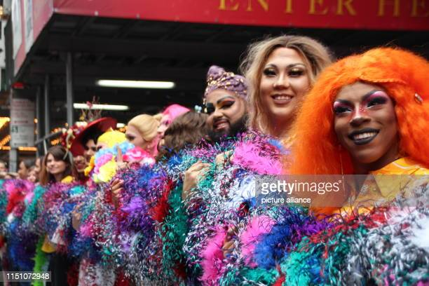 Drag Queens unroll a rainbow feather boa on Times Square At 19195 metres the Boa represents a new world record The event took place on the occasion...
