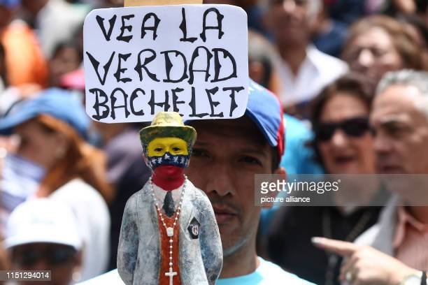 Look at the truth Bachelet stands over the figure of Venezuelan physician Jose Gregorio Hernandez in a protest outside the United Nations Development...