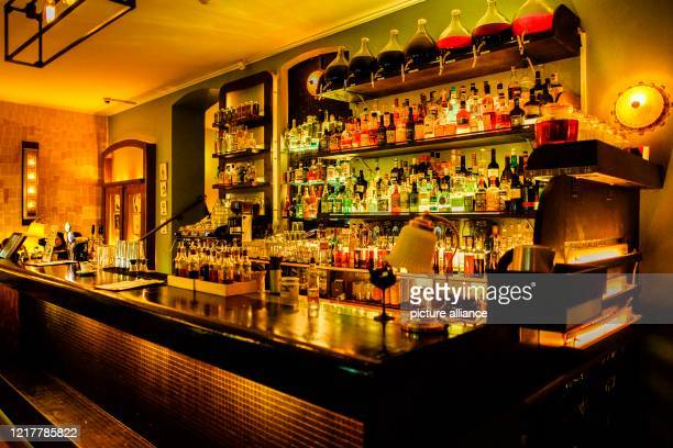 """List of drinks is available at the bar in the """"Limonadier"""" cocktail bar in the Kreuzberg district. After the Corona-related closure, pubs and bars..."""