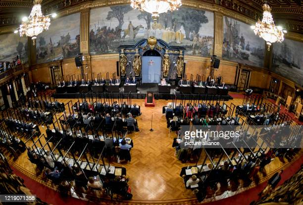 June 2020, Hamburg: The delegates meet at the meeting of the Hamburg Parliament at their seats, which are individually separated by Plexiglas panels...