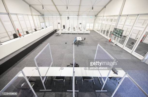June 2020, Hessen, Limburg: In the foreground of the courtroom are the seats for the accused and defence lawyers, separated by plastic panels. The...