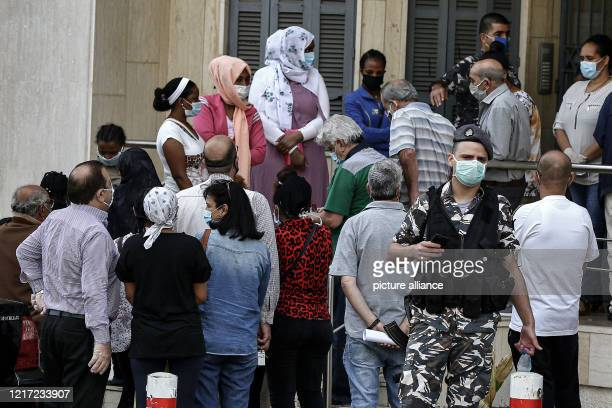 June 2020, Lebanon, Hazmiyeh: Ethiopian maids gather in front of the main entrance of the Ethiopian Consulate in the Hazmiyeh town, south-east of...