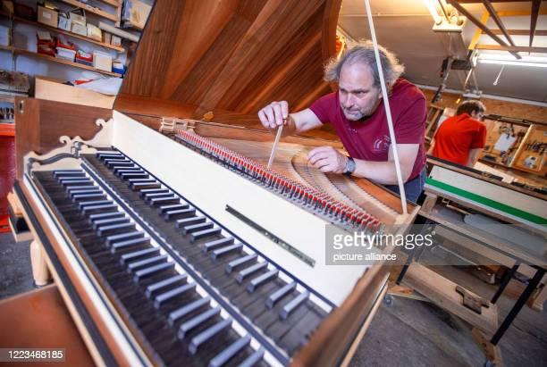 22 June 2020 MecklenburgWestern Pomerania Rostock Instrument maker JohannGottfried Schmidt is working on a replica of a harpsichord after Michael...