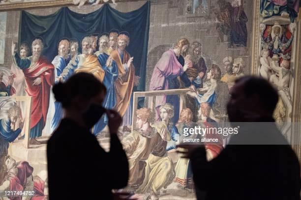 """June 2020, Saxony, Dresden: Participants of a press tour stand with face masks in the exhibition """"Raphael - Power of Images. The Tapestries and their..."""
