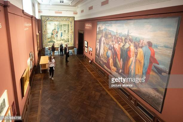 """June 2020, Saxony, Dresden: Participants of a press tour will stand in the exhibition """"Raphael - Power of Images. The Tapestries and their Effect"""" in..."""