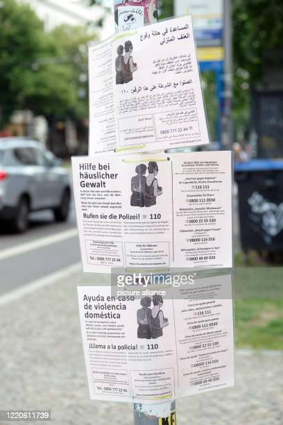 June 2020, Saxony, Leipzig: Notices in various languages on the subject of domestic violence in connection with Corona are hung on a street. Photo:...