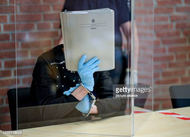 June 2020, Schleswig-Holstein, Itzehoe: The defendant in the trial for attempted rape is waiting behind a Plexiglas panel for the trial to begin. On...
