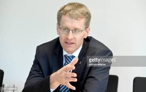 June 2020, Schleswig-Holstein, Kiel: Daniel Günther , Minister President of Schleswig-Holstein, sits in the state house of Kiel during an interview....