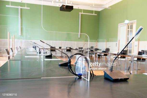 June 2020, Schleswig-Holstein, Kiel: Plexiglas panels are installed as partitions between the tables in a conference room in the Kiel parliament....