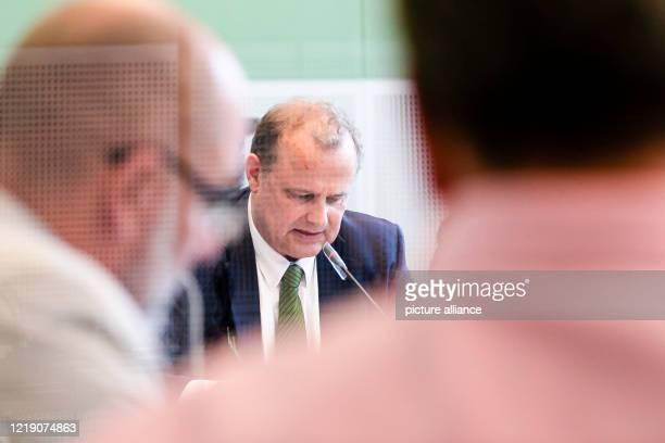 June 2020, Schleswig-Holstein, Kiel: Schleswig-Holstein's Minister of Justice Claus Christian Claussen can be seen through a Plexiglas panel during a...
