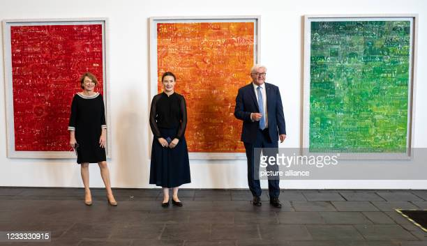 """Federal President Frank-Walter Steinmeier and his wife Elke Büdenbender stand next to Spanish artist Cristina Lucas at the opening of the """"Diversity..."""