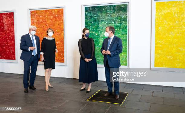 Federal President Frank-Walter Steinmeier and his wife Elke Büdenbender chat with Armin Laschet , Minister President of North Rhine-Westphalia, at...