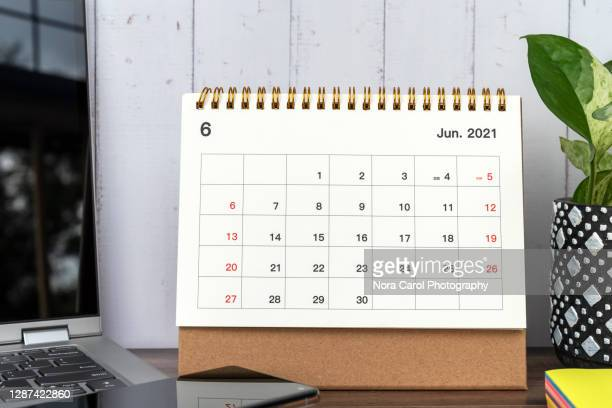 june 2021 calendar on a desk - june stock pictures, royalty-free photos & images