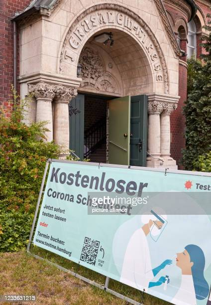 """June 2021, Hamburg: A banner with the inscription """"""""Free Corona Quick Test"""""""" stands in front of the entrance of the Jerusalem Church in..."""