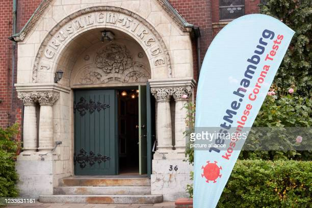 """June 2021, Hamburg: A banner with the inscription """"""""testMe.hamburg free Corona tests"""""""" stands in front of the entrance of the Jerusalem Church in..."""