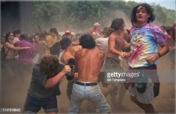 June 21, 1993 ]: Moshing during the Lollapalooza music festival on June 21, 1993 in New York City.