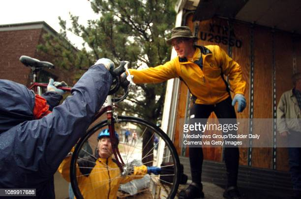 June 21 2004 / Estes Park CO / Todd Squillante left of Louisville CO and Dean Gorrell right of Madison Wis help Pat DeBever with her bike before...