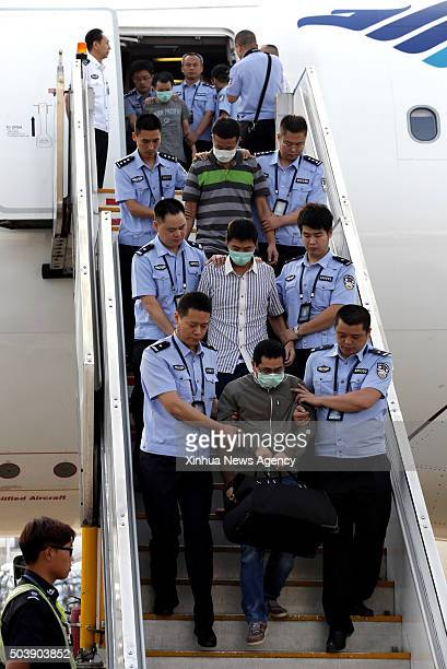 June 21, 2015 -- Six fugitives involvoed in economic crimes are taken back under escort from Indonesia at Capital International Airport in Beijing,...