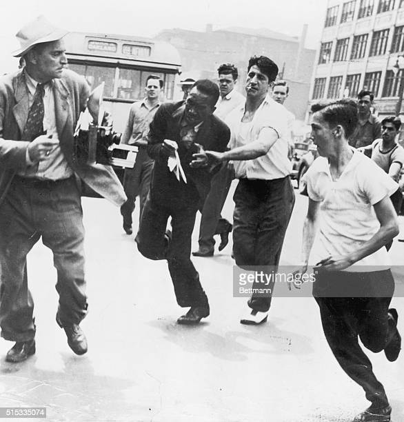 June 22 1943Detroit Michigan This negro center has just been slugged by young white hoodlums in Detroit's race riot and is frantically trying to...