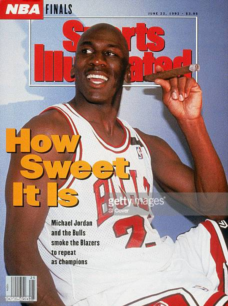 June 22 1992 Sports Illustrated via Getty Images CoverBasketball NBA Finals Chicago Bulls Michael Jordan victorious smoking cigar in locker room with...