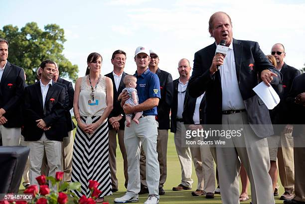 Chris Berman of ESPM introduces winner Kevin Streelman his with Courtney and daughter Sophie during the trophy presentation for the Travelers...