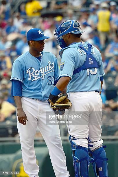 Kansas City Royals' catcher Salvador Perez talks with his pitcher Kansas City Royals' pitcher Yordano Ventura during a major league baseball game...