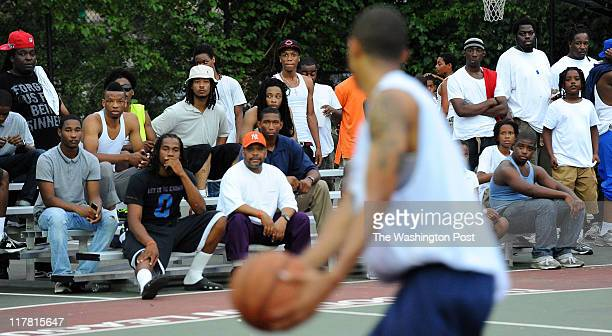 Crowds jam the sidelines to watch the action during the Goodman League summer basketball tournament at Barry Farms on June 22 2011 in Washington DC