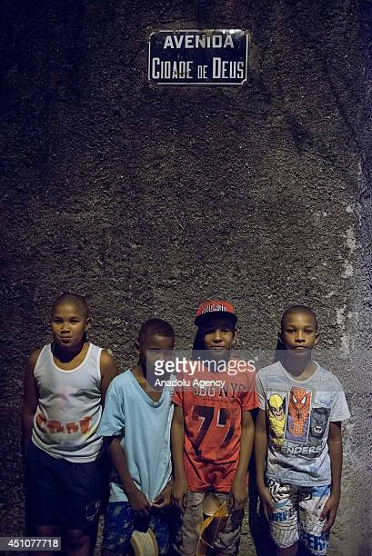 June 23, 2014 dated pictures show the daily life and the residents of Cidade de Deus, known as CDD among their inhabitants. Cidade de Deus, City of...