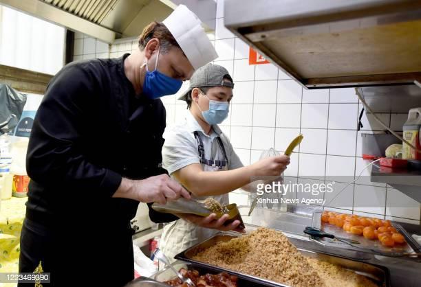 June 23, 2020 -- Spaghetti chef Suman L makes Zongzi at restaurant Pizzeria Don Giovanni in Vienna, Austria, June 23, 2020. Zongzi is a traditional...