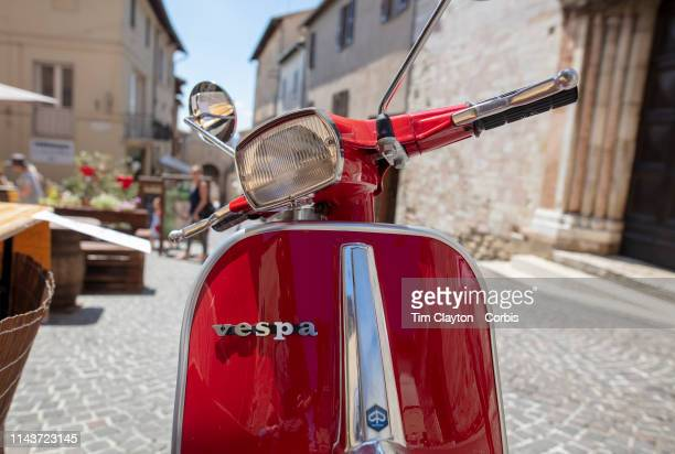 June 23: A red Vespa Scooter in a street scene in Montefalco, Italy. Montefalco is a town in the central part of the Italian province of Perugia, on...