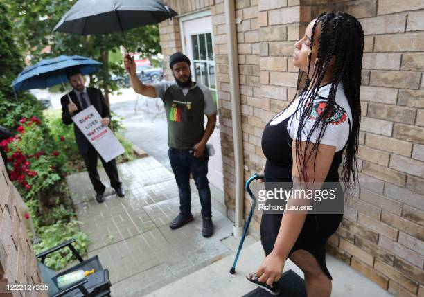 June 23 Chantelle relives the moment where she was shot on her front stoop as her partner Michael and her lawyer Davin Charney look on following the...