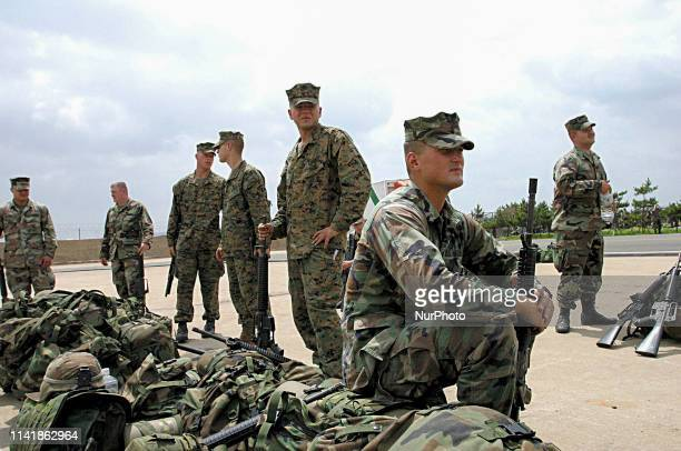 June 24, 2003-Pohang, South Korea-US Marine wait for their base Okinawa, Japan after land cross drill 'Foal Eagle' at military port in Pohang, South...