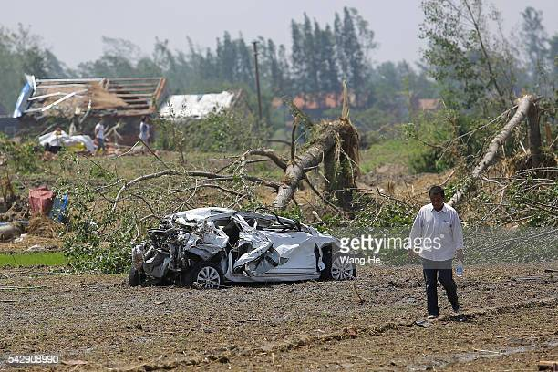 YANCHENG CHINA June 24£¬ The villagers after the destruction of the car in Danping Village of Chenliang Township in Funing Yancheng east China's...