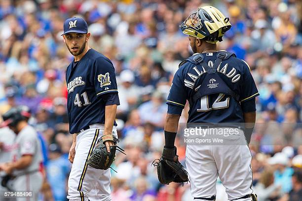 Milwaukee Brewers Starting pitcher Marco Estrada [5836] talks with Milwaukee Brewers Catcher Martin Maldonado [8459] during a game between the...