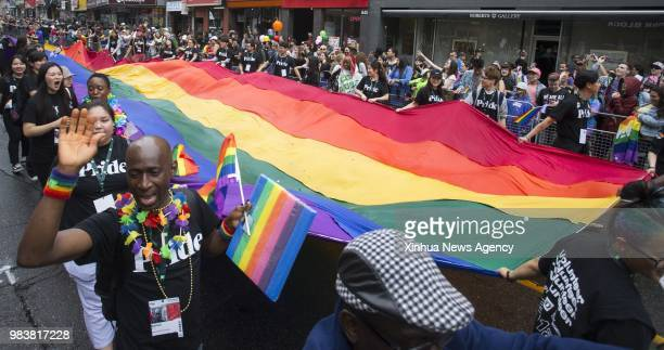 TORONTO June 25 2018 People take part in the 2018 Toronto Pride Parade in Toronto Canada June 24 2018