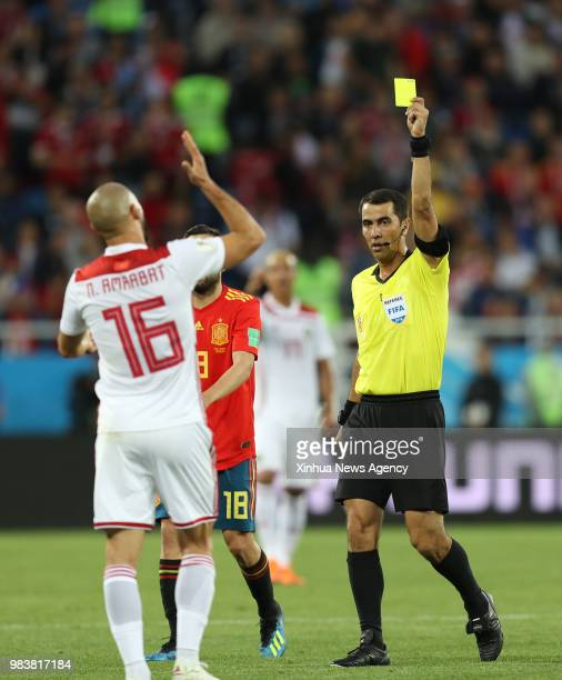 KALININGRAD June 25 2018 The referee gives a yellow card to Noureddine Amrabat of Morocco during the 2018 FIFA World Cup Group B match between Spain...