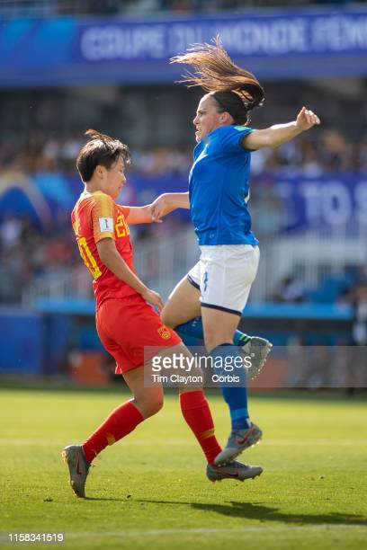 June 25 Alia Guagni of Italy clears while challenged by Zhang Rui of China during the Italy V China round of sixteen match at the FIFA Women's World...